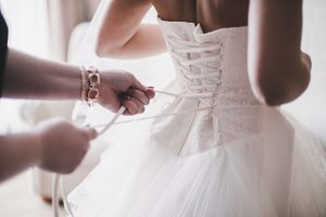 Tying up wedding dress